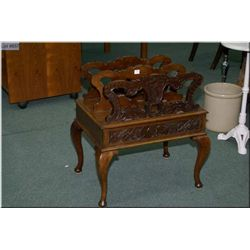 An antique mahogany Canterbury with hand carved lion  and shield plus musical motif carved drawer on