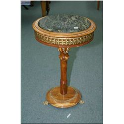 A marble topped occasional table with brass ormolu decoration