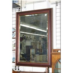 "A wood and gilt framed bevelled wall mirror 42"" X  30"""