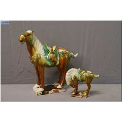 Two Majolica glazed pottery horses