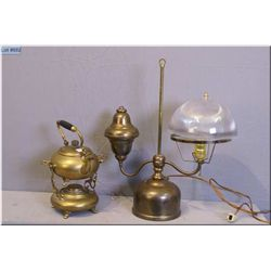 A converted gas lantern and a vintage brass spirit  kettle