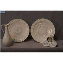 Four pieces of Irish Belleek including two green  mark plates, a brown mark pitcher and a blue mark
