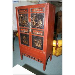 A two door hand painted and carved Oriental cabinet