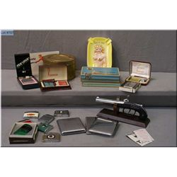 A vintage antelope motif ashstand and a selection of tobacco related items including lighters, tobac