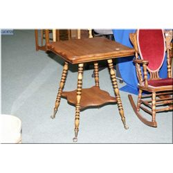 An antique quarter cut oak Canadiana lamp table  with turned supports and cast and glass ball and  c