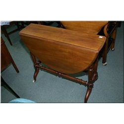 A mahogany drop leaf occasional table with turned  support and modified cabriole legs on castors
