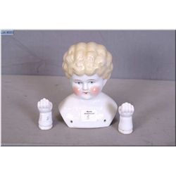 A vintage china doll head and hands