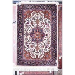 """A wool area rug with center medallion and floral pattern in shades of navy, red and cream 48"""" X 74"""""""
