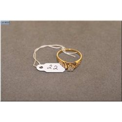 Lady's 14kt yellow gold and diamond ring set with 0.33ct brilliant white solitaire diamond and 0.24c