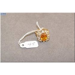 Lady's 14kt yellow and white gold sapphire and diamond ring set with 2.10ct natural oval orange sapp