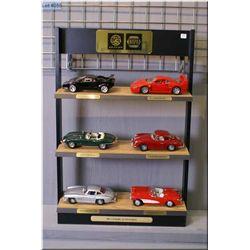 A collection of die-cast cars including Mercedes, Jaguar, Porsche, Ferrari, Lamborgini, and Corvet o