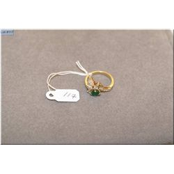 Lady's 14kt yellow and white gold diamond and emerald gemstone ring. Set with 0.65ct natural  oval s