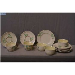 A collection of Black mark Belleek including five cups and saucers and sandwich plates