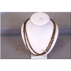 "A 36"" strand of natural Tiger's eye gemstones"