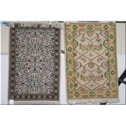 Two small area rugs both with geometric patterns