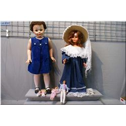 """Two vintage walking dolls and a set of """"Heart family"""" dolls"""