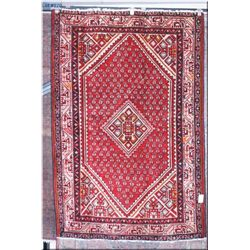 """An Iranian wool area rug with center medallion and small geometric pattern, multiple border 5'2"""" X"""
