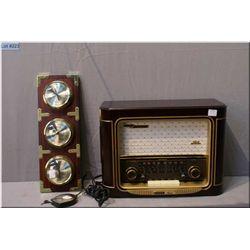 A Grumdig replica table top radio and a three gauge barometer