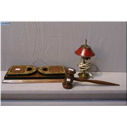 A vintage brass bound folding and adjustable book holder, a wooden gavel and a small cast miniature