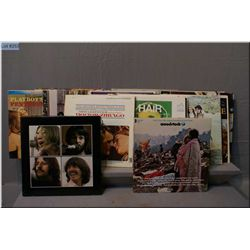 A selection of vintage Rock N' Roll vinyl albums including Woodstock, Blood, Sweat and Tears,  Beatl
