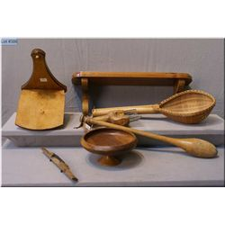 A selection of primitive treenware including shelves, berry picker, spoke shave, wooden  comport, bo