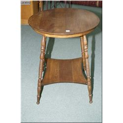 A vintage two tier Canadiana occasional table