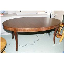 A modern Ethan Allen dining table with two leaves
