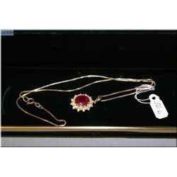 Lady's 14kt yellow gold, ruby and diamond pendant set with 5ct oval cut ruby and 0.56ct of brilliant