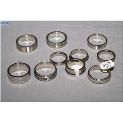 Ten Men's stainless steel rings including spinners, plain bands and engraved rings