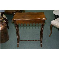 A single drawer mahogany console table with bobbin turned supports and stretchers