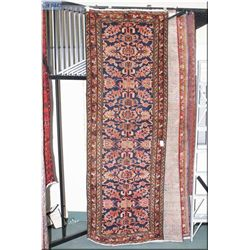 An Iranian wool runner with overall geometric pattern in shades of navy and muted salmon and red  to