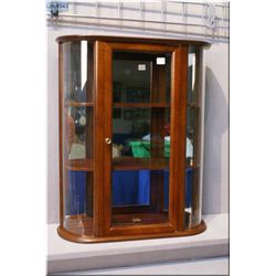 A wall mount wooden display cabinet with two shelves and glazed doors