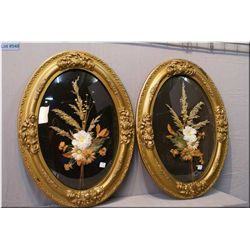 Two large oval convex glass and gilt framed floral arrangements