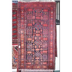 An Iranian made wool area rug with overall geometric pattern and wide multiple border is  shades of