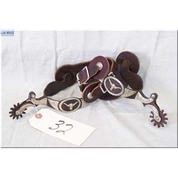 Pair of Ornate Riding Spurs, w/Colarado Saddlery Co. USA mkd on leathers, silver toned engraved over