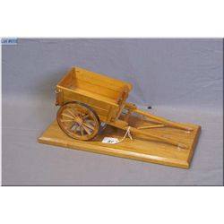 "Wooden Scale Model of "" Old Time Red River Cart"" mounted on wooden base , 15"" x 7 1/2"""