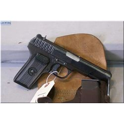 Tokarev semi automatic pistol with holtser, one magazine and rod, 7.62x25. S/N 2797