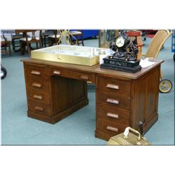 Double pedestal oak desk with eight drawers, two pull out trays, professionally refinished
