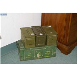Four army green ammunition boxes