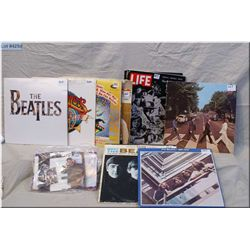 Selection of Beatles albums and memorabilia