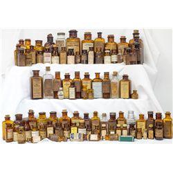 One hundred (100) labeled drug bottles -