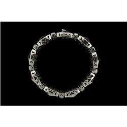 BRACELET: Mens 14kw ''invisible'' set diamond link bracelet; 634 sq prin dias, 1.7mm-1.9mm = est 21.
