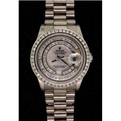 ROLEX: Mens 18kw Rolex O.P. Day Date wristwatch w/ aftmkt diamond apptmnts; white MOP dial; dial bez