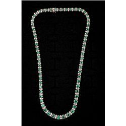 NECKLACE:  [1] 18KWG 171/2'' necklace set with 66 oval emeralds, approx. 12.00 cttw, light - moderat