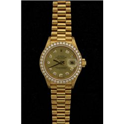 ROLEX: Ladys 18ky Rolex O.P. Datejust diamond wristwatch; 26.1mm case; champagne dial w/ 10 rd dias,