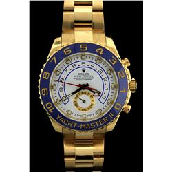 ROLEX: Mens 18ky Rolex O.P. Yachtmaster Chrono wristwatch; 44mm case; white dial, blue ceramic bezel