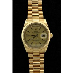 ROLEX: Mens 18ky Rolex O.P. Day Date wristwatch; champagne dial w/ stick markers; 36.3mm case; flute