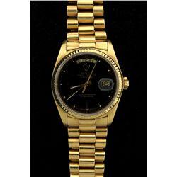 ROLEX: Mens 18ky Rolex O.P. Day Date wristwatch; black dial w/ stick index; fluted bezel; syn saph c