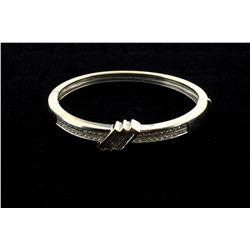 BRACELET: Ladys 18kw ''invisible'' set diamond bangle bracelet (hinged); 65 sq prin dias, 2.0mm-2.1m