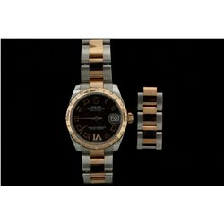 ROLEX: Ladys st.steel & 18kr Rolex O.P. DateJust diamond wristwatch; 31mm case; chocolate dial w/ 18
